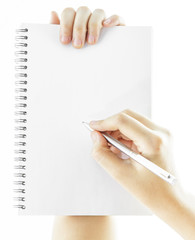Blank notebook with hand holding a pen