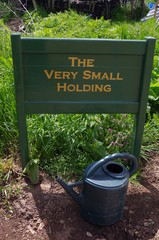 The Very Small Holding Sign