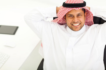 above view of middle eastern businessman relaxing in office