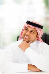 arabian businessman daydreaming