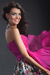 Portrait of a beautiful girl in a light summer dress