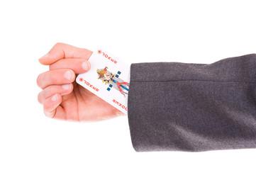 Businessman with Joker card hidden under sleeve.