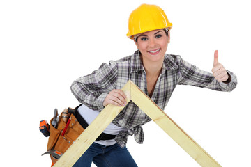 Female carpenter with truss