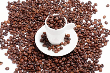 a cup of coffee beans on white background