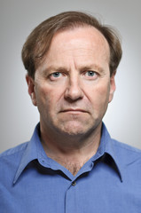 Mature Caucasian Man With Blank Expression Portrait
