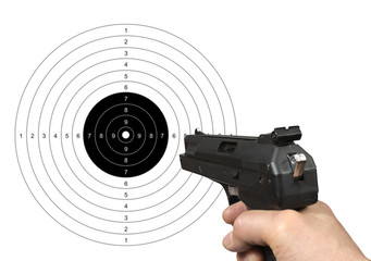 Hand holding gun shooting target with clipping path.