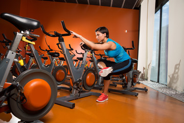 Aerobics spinning woman stretching exercises after workout