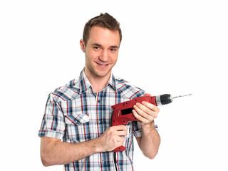 Junger Mann mit Bohrmaschine
