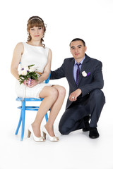 Portrait of Caucasian groom and Asian bride.