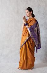 woman in a sari  white background