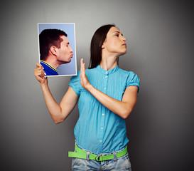 woman refuses kissing men