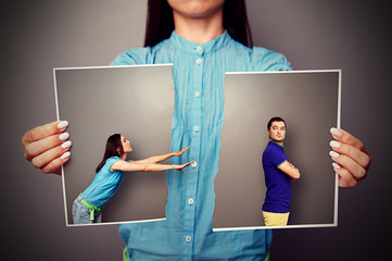 woman stretching her hands to resentful man