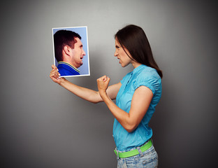 woman showing fist to scared man
