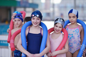 happy children group  at swimming pool