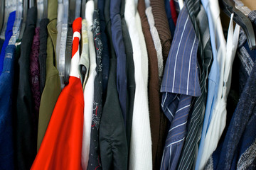 Close up of clothing, red shirt on left