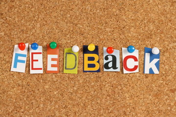 Wall Mural - The word Feedback on a cork background