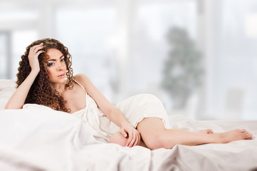 young woman on bed