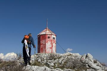 Man coming on top of mountain Mosor in Croatia