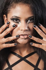 Beautiful woman is showing nails. Fashion portrait. Close-up fac