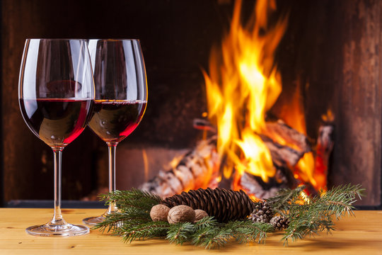 red wine at cozy fireplace