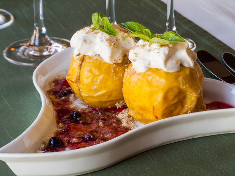 yellow baked apples with jam and cream