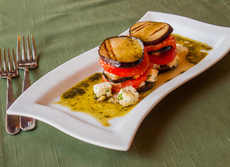 grilled eggplant with tomatoes​, in olive sauce with cheese