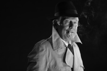 Retro mafia man with hat smoking cigarette. Black and white phot