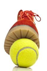 Tennis ball under sole of shoe