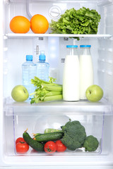 Open refrigerator with vegetarian food