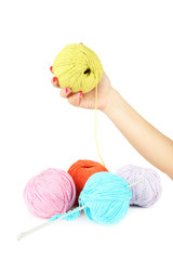 Hands of young woman with colorful wool balls for knitting ,