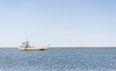 Wooden fishing boat in sea