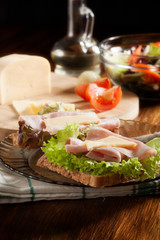 Sandwiches with cheese, ham and lettuce. Dark tone
