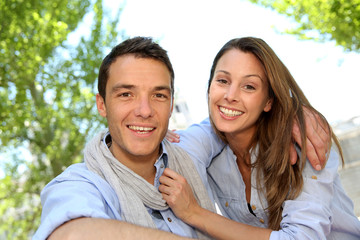 Cheerful couple relaxing in park