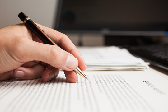 Man checking text on a business document