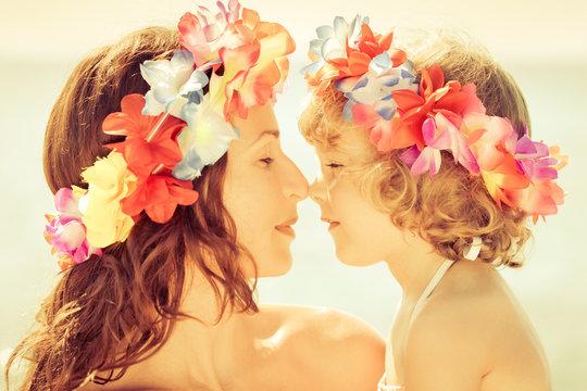 Woman and child wearing hawaiian flowers garland
