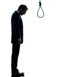 Man Sad Standing In Front Of Hangman Noose Silhouette