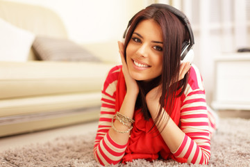 Young beautiful woman in bright outfit enjoying the music