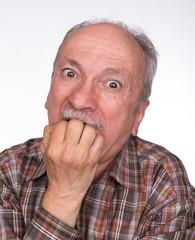 Portrait of a very surprised elderly men