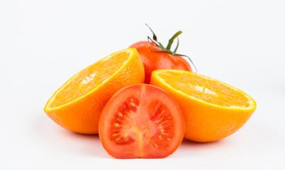 orange and tomato isolated on white