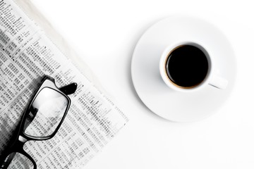 coffee near financial newspaper and glasses