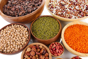 Different kinds of beans in bowls close-up