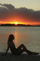 Silhouette of young woman at sunset, Boca Chica bay