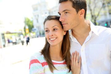 Sweet couple walking in city avenue