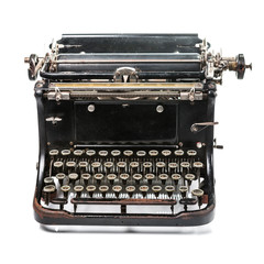 Old rusty and dusty typewriter on white background
