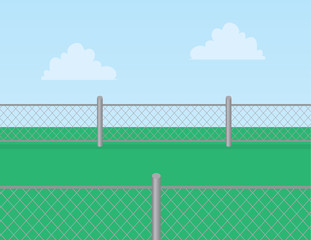 Chain linked fence in grassy field