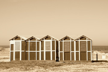 old wooden cabin on the sand near the sea in rimini, italy
