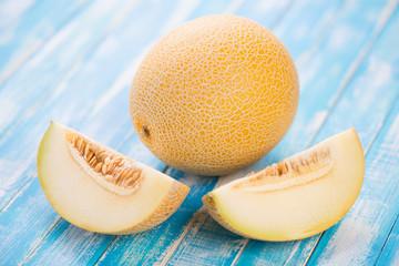 Horizontal shot of ripe Galia melon and its segments