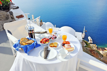 Breakfast on a terrace overlooking the sea in Oia