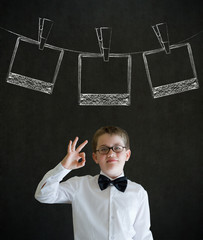 Boy business man with instant photo photograph on clothes line
