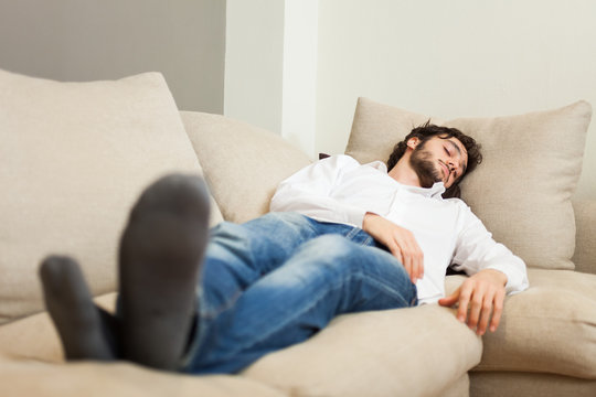 Man relaxing on his couch